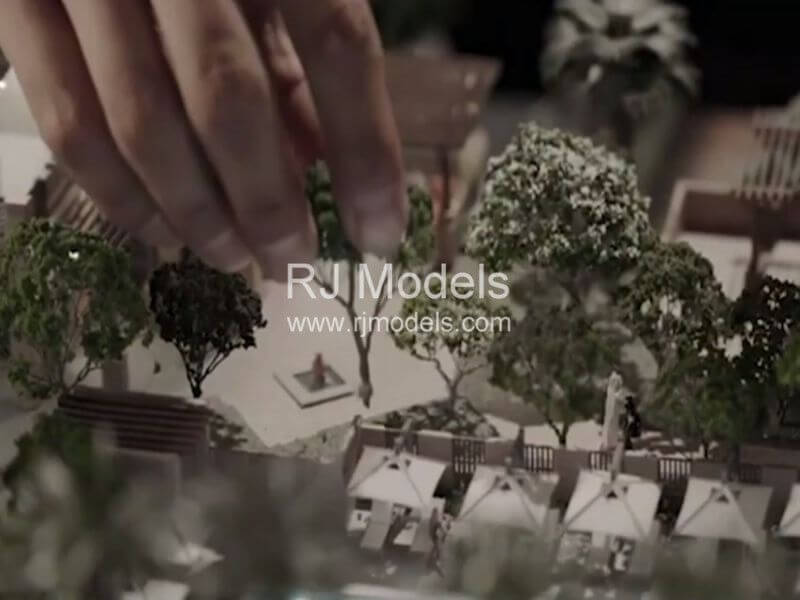 Architectural model builder create mini landscapes with trees